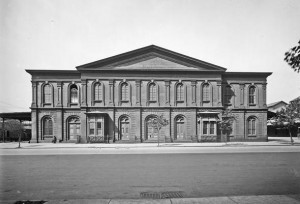 A black and white photograph of a Pennsylvania Railroad freight depot