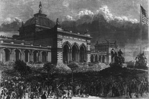 woodcut engraving of memorial hall in 1876. The building has a domed center and arched door ways leading to the center entrace. a large crowd is gathered around the grounds looking to the stairs of the building