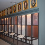 Photograph of portraits displayed in a gallery