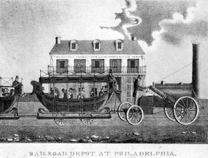 a black and white engraving of an early railroad depot in Philadelphia with train in front