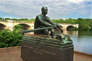 "color photograph of ""The Rower,"" a sculpture of John B. Kelly Sr., with Schuylkill River in background."
