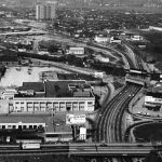 A black and white aerial photograph of the former Sears, Roebuck & Company building and Admiral Wilson Boulevard