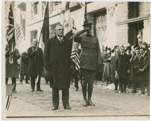 a black and white photograph of William Cameron Sproul and son Jack leading the Armistice Day Parade