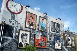 A color photograph of a mural with portraits of Philadelphia musicians
