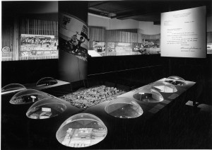 black and white photo showing a display at the Better Philadelphia Exhibition of 1947, with nine plexiglas domes rising from a table surface, lit from within to show building proposals.