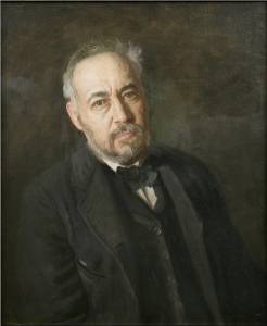 A self-portrait painting of Thomas Eakins leaning backward at an angle. He wears a black vest, suit jacket, and bow tie.  He has salt-and-pepper grey hair, beard and mustache.  The background is splotchy, somewhat abstract mixture of brown and dark grey tones.