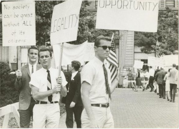 Black and white photograph of three men picketing for gay rights in front of Independence Hall.