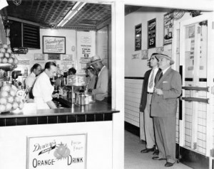 Black and white photograph of the inside of a Dewey's restaurant in the 1950s.