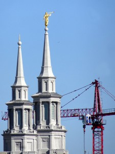 An image of the Mormon temple in Philadelphia, prominently featuring a gold statue of the Angel Moroni.