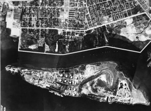 A black and white aerial image of Petty Island and the north shore of Camden
