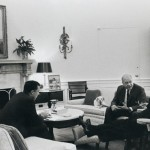 Department of Housing and Urban Development Secretary Robert C. Weaver meets with President Lyndon B. Johnson and an unidentified individual in the Oval Office at the White House, 1967