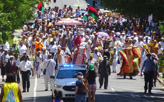 color photo of ODUNDE festival celebrants moving west on South Street to present offerings at the Schuylkill River.