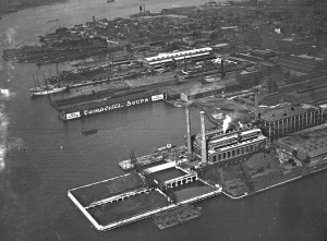 An image of Camden's industrial piers during the early twentieth century, with manufacturing plants for Campbell's Soup and RCA Victor visible.