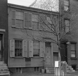 A black and white photograph of Walt Whitman's house in Camden, New Jersey.