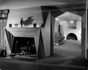 A black and white photograph of the fireplace and doorway from the Bok House library.
