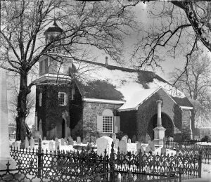 A black and white photograph of the Holy Trinity church and grave yard in Wilmington, Delaware