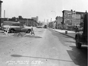 a black and white photograph of Market Street at Thirty Sixth street prior to the construction of the University City Science Center showing residences and business