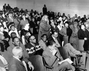 A black and white image of community members at a meeting at the Drew School to discuss plans for the Unit 3 project