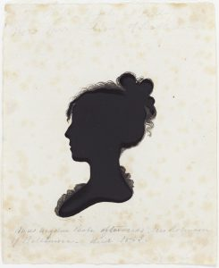 A hollow-cut profile silhouette created using a Physiognotrace, or device that drew an outline of a figure or object. The outline was then cut out and had details added with black ink (with a black piece of paper showing through the cutout for shadow-like contrast).