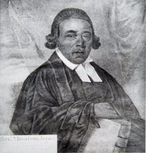 Black and gray portrait, seated with bible, half length.