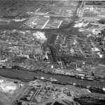 Black and white aerial photograph of oil refinery.