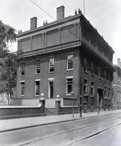 A black and white photograph of Philosophical Hall showing library extension on top