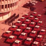 Aerial view of red Philadelphia Police Cars outside of the Police Administration Building.