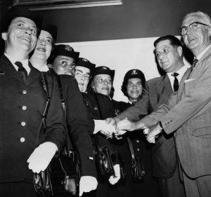Police Commissioner Frank L. Rizzo and Mayor James H.J. Tate promoting several female police officers.