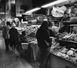 Customers browse the produce section of the Reading Terminal Market