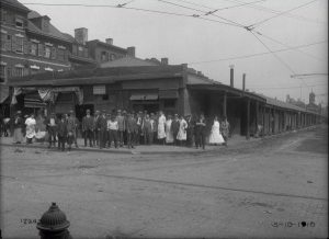 People standing outside of a restaurant and coffee house in 1916.