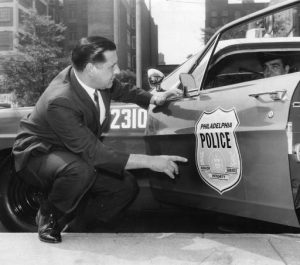 Police Commissioner Frank Rizzo Examining the New Police Insignia.