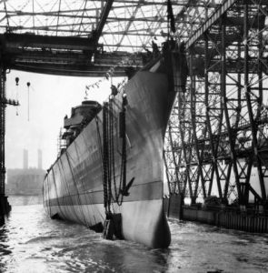 A black and white photograph of the USS Norfolk launching at the New York Shipbuilding Company of Camden New Jersey