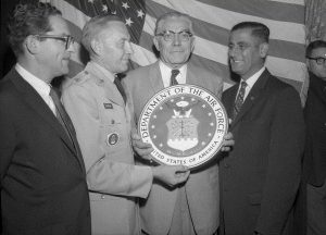 Members of the Air Force presenting the Philadelphia Veterans Advisory Commission with a plaque.