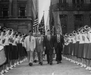 Leaders of the Veterans of Foreign Wars (VFW) walk through two lines of the Audubon All-Girl Drum and Bugle Corps at a ceremony at City Hall in Philadelphia in 1954.