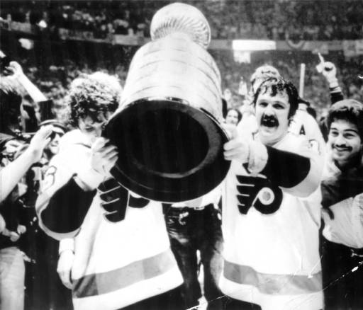 Flyers Bobby Clarke and Bernie Parent celebrate with the Stanley Cup in 1974