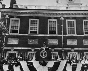 President John F. Kennedy in front of Independence Hall delivering a July 4th address.