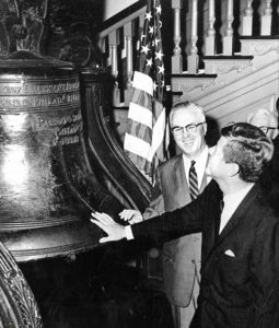 President Kennedy and Philadelphia Mayor Tate touching the Liberty Bell.