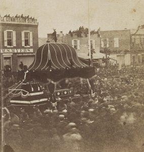 President Lincoln's funeral carriage moving down a crowded Broad street in 1865.