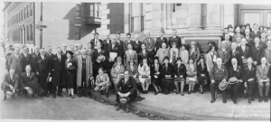 A black and white photograph of the members of the 1929 American Ornithologists' Union meeting held in the Academy of Natural Sciences. Participants are posed seated or standing in rows.