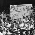 Philadelphia Phillies fans hold a banner that reads