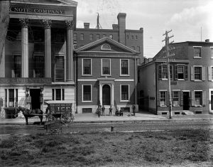 a black and white photograph of the Philadelphia Dispensary, a two story building