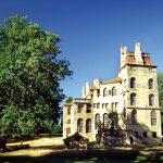 A color photograph of a mansion built out of concrete