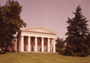 A color photograph showing a Greek Revival style entrance to a mansion with six front columns