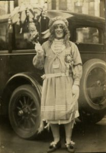 Photographic postcard (1924) depicts an unidentified mummer in a typical wench costume.