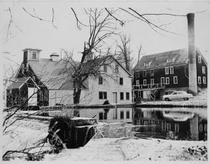 A black and white photograph of the Garret Snuff Mill, situated on the Brandywine Creek.
