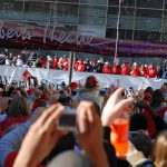 color photo of crowd of fans cheering parade float carrying Philadelphia Phillies team after World Series victory in October 2008.