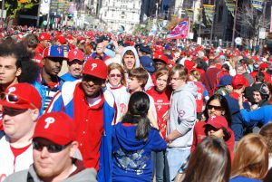 Color photo of Exuberant fans filling Broad Street south of City Hall after the parade honoring the victorious 2008 Philadelphia Phillies baseball team had passed