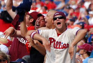 "Enthusiastic Phillies fans take part in a ""bongo cam"" exercise being shown on the giant Phanavision screen during a game in August 2009.  (Photograph by Donald D. Groff for the Encyclopedia of Greater Philadelphia)"