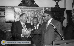 a black and white photograph of Mayor Ed Rendell shaking hands with Kenny Gamble and Leon Huff