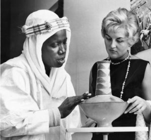 he Nigerian legislator Alhaji Umaru Gwandu, shown here at left, explains the significance of the decorations on a pottery jug from northern Rhodesia (now known as Zimbabwe).